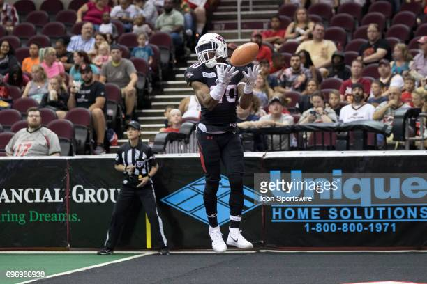 Cleveland Gladiators DB Kenny Veal leaps as he fields a kickoff off the end zone netting during the second quarter of the Arena League Football game...