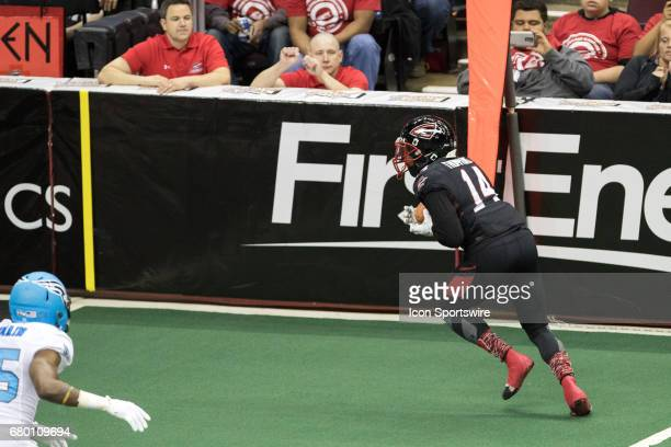 Cleveland Gladiators WR Brandon Thompkins heads to the end zone as he scores on a 7yard touchdown pass during the first quarter of the Arena Football...
