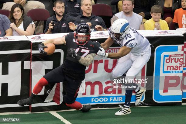 Cleveland Gladiators WR Collin Taylor is tackles on a kickoff return by Baltimore Brigade WR Paul Browning during the third quarter of the Arena...