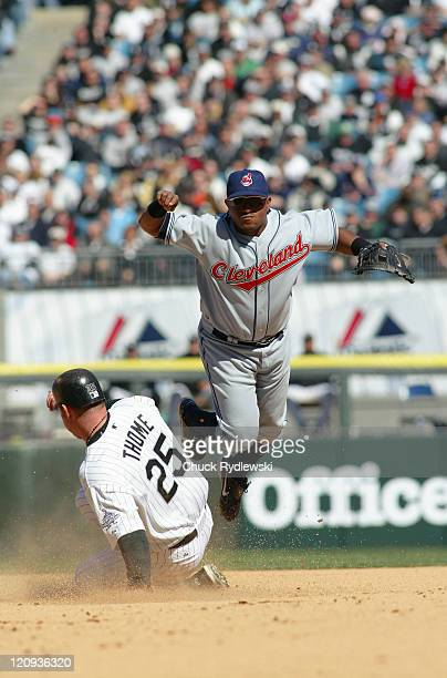 Cleveland Indians' 2nd Baseman Ronnie Belliard eludes Jim Thome and turns a double play during the game against the Chicago White Sox April 4 2006 at...