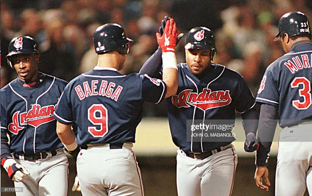 Cleveland Indians Albert Belle (2nd R) is greeted : News Photo