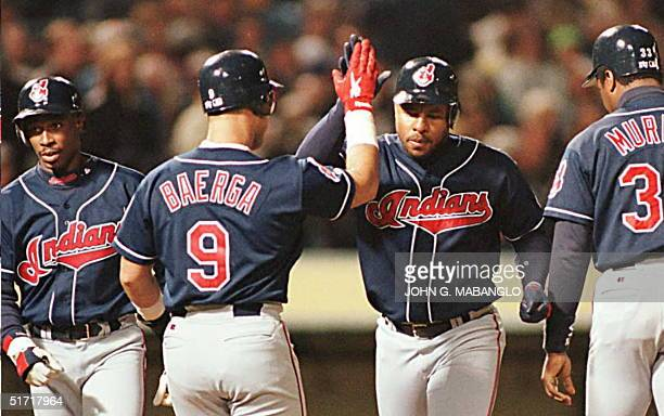 Cleveland Indians Albert Belle is greeted by teammates Carlos Baerga Kenny Lofton and Eddie Murray after Belle hit a threerun homerun off Oakland...