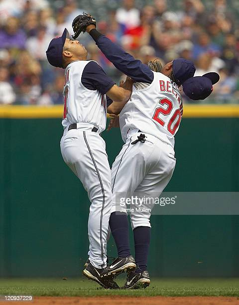 Cleveland Indians' Alex Cora left and Ronnie Belliard collide after going for a ball hit by Minnesota Twins' Shannon Stewart in the fourth inning...