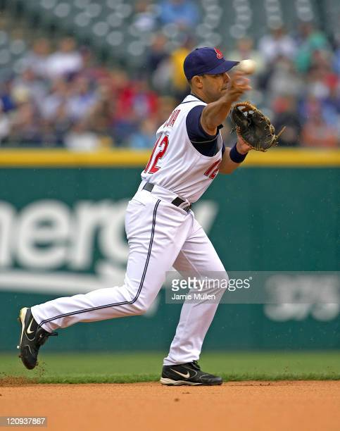 Cleveland Indians' Alex Cora makes a play to first base during the game against the Minnesota Twins Sunday April 17 2005 in Cleveland Ohio The...