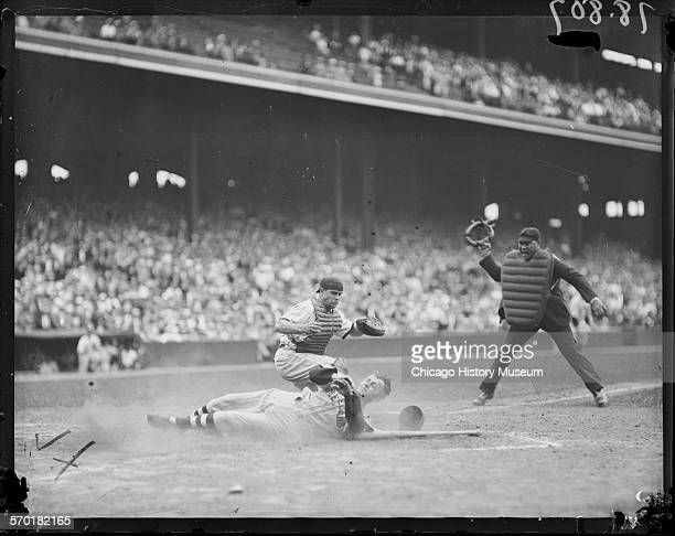 Cleveland Indians baseball player sliding into home plate at Comiskey Park Chicago Illinois circa 1930