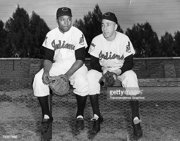 Cleveland Indians battery mates former Negro Leaguer Quincy Trouppe, catcher, on the right and Sad Sam Jones talk over the upcoming season at spring...