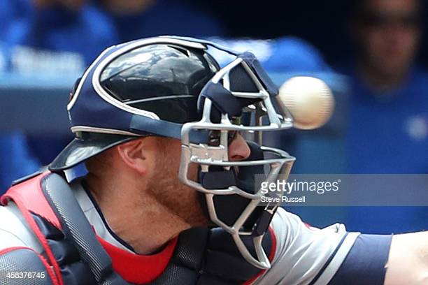 Cleveland Indians catcher Chris Gimenez takes a foul off his mask as the Toronto Blue Jays play the Cleveland Indians at the Rogers Centre in...