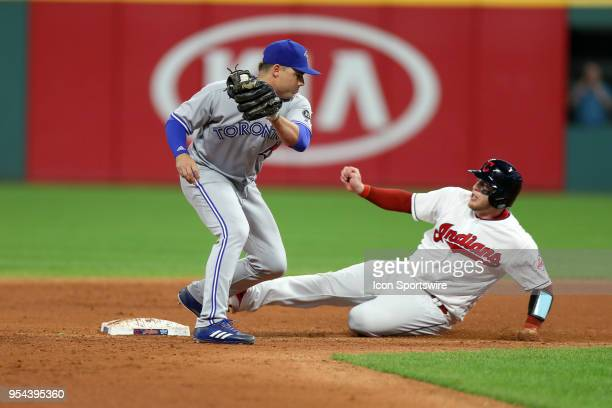 Cleveland Indians catcher Roberto Perez slides safely into second base ahead of the tag by Toronto Blue Jays infielder Aledmys Diaz as he advanced on...