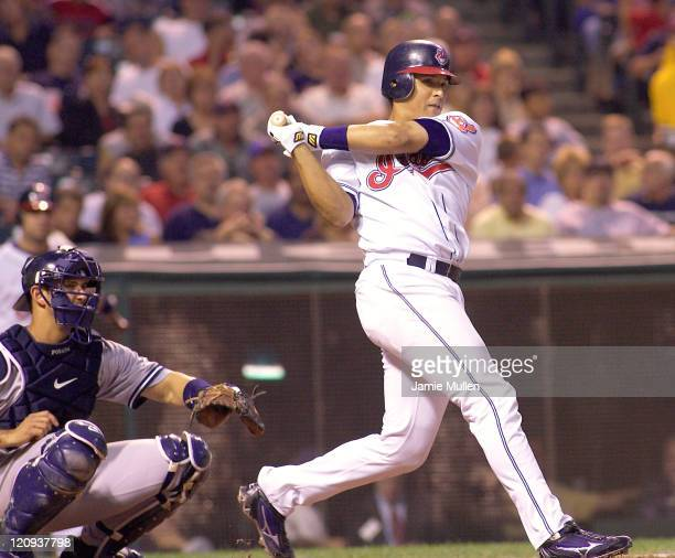 Cleveland Indians' catcher Victor Martinez bats during the game against the New York Yankees Monday August 23 2004 in Jacobs Field in Cleveland Ohio...