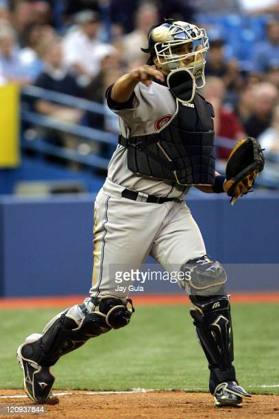 Cleveland Indians catcher Victor Martinez throws to 1st for an out against Toronto Blue Jays at the Rogers Centre on August 26, 2005.