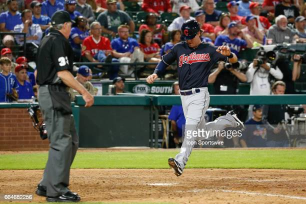 Cleveland Indians Center field Tyler Naquin comes around to score the go ahead run during the 9th inning of the MLB opening day baseball game between...