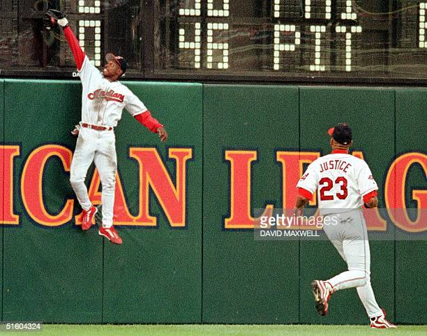 Cleveland Indians center fielder Kenny Lofton makes a leaping catch at the wall to put out Minnesota Twins second baseman Todd Walker as Indians left...
