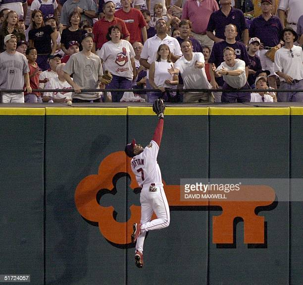 Cleveland Indians center fielder Kenny Lofton makes a leaping catch at the wall on a ball hit by Seattle Mariners batter Carlos Guillen in the...