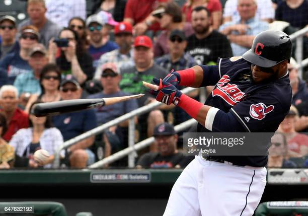 Cleveland Indians designated hitter Carlos Santana breaks his bat on a pitch by Colorado Rockies starting pitcher Jeff Hoffman during the first...