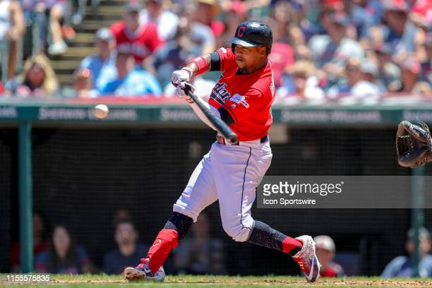 Cleveland Indians designated hitter Carlos Santana points to Cleveland Indians third baseman Jose Ramirez as he scores on the double hit by Ramirez...