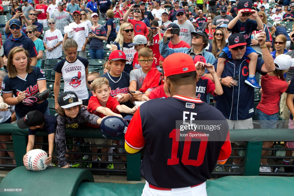 Cleveland Indians designated hitter Edwin Encarnacion (10) signs autographs for fans prior to the Major League Baseball game between the Kansas City Royals and Cleveland Indians on August 27, 2017, at Progressive Field in Cleveland, OH. Cleveland defeated Kansas City 12-0.