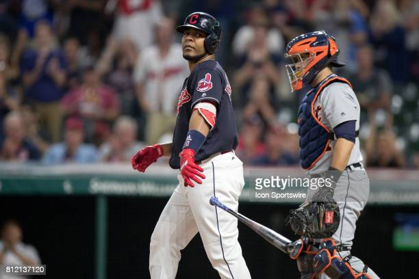 Cleveland Indians designated hitter Edwin Encarnacion tosses his bat towards the dugout after drawing a walk during the eighth inning of the the...