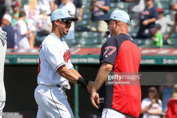 Cleveland Indians designated hitter Michael Brantley and Cleveland Indians manager Terry Francona celebrate following the Major League Baseball game...