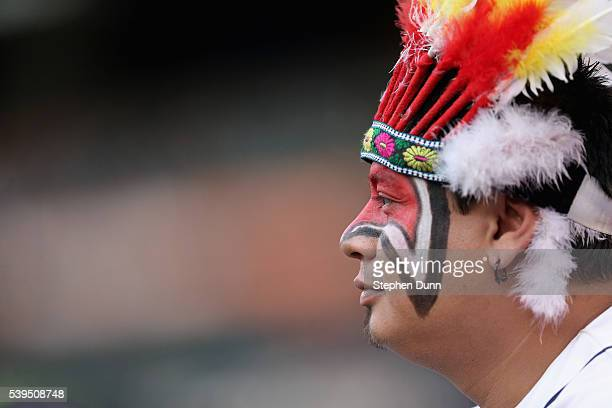 Cleveland Indians fan in makeup and a headress looks on before the game withthe Los Angeles Angels of Anaheim at Angel Stadium of Anaheim on June 11,...