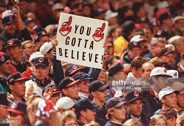 "Cleveland Indians fan in the crowd at Cleveland's Jacobs Field holds up a sign reading ""Ya Gotta Believe"" at the start of game three of the World..."