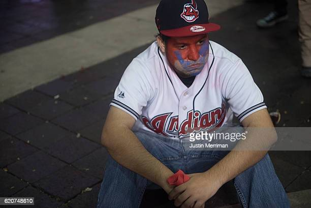 Cleveland Indians fan sits in the street after the Chicago Cubs defeated the Cleveland Indians in game 7 of the World Series in the early morning...
