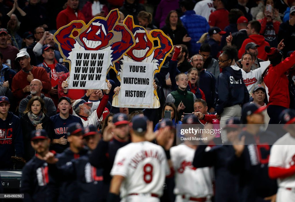 Cleveland Indians fans celebrate as players leave the field after defeating the Baltimore Orioles at Progressive Field on September 10, 2017 in Cleveland, Ohio. The Indians defeated the Orioles 3-2, and their win streak now stands at 18.