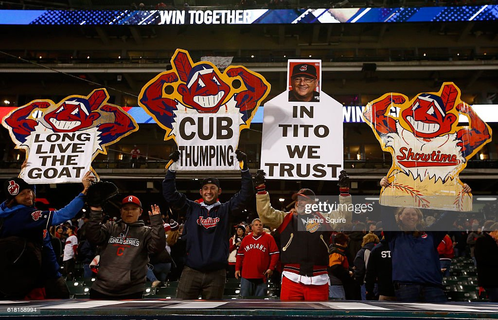 Cleveland Indians fans hold signs after the Cleveland Indians defeated the Chicago Cubs 6-0 in Game One of the 2016 World Series at Progressive Field on October 25, 2016 in Cleveland, Ohio.