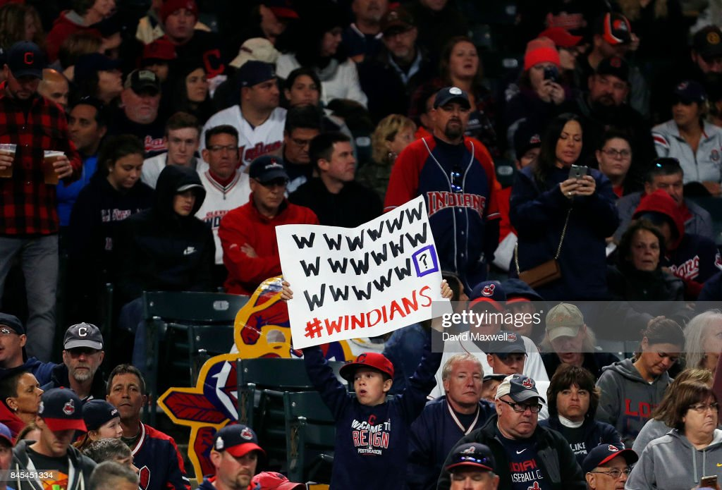 Cleveland Indians fans hold signs supporting the Indians' win streak in the ninth inning against the Baltimore Orioles at Progressive Field on September 10, 2017 in Cleveland, Ohio. The Indians defeated the Orioles 3-2, and their win streak now stands at 18.