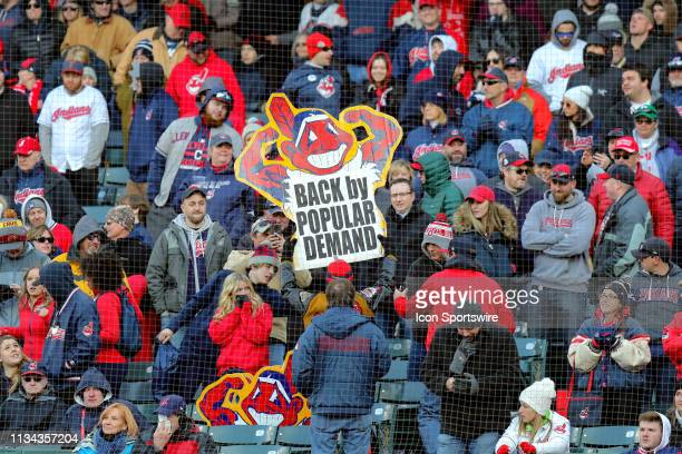 Cleveland Indians fans hold up a Chief Wahoo sign during the eighth inning of the Major League Baseball home opener between the Chicago White Sox and...