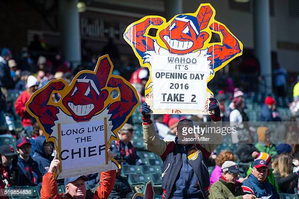 Cleveland Indians fans hold up Chief Wahoo signs prior to the game against the Boston Red Sox the opening day game at Progressive Field on April 5...