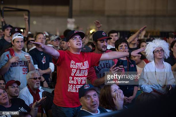Cleveland Indians fans react as they watch the big screen outside of Progressive Field during game 7 of the World Series between the Cleveland...