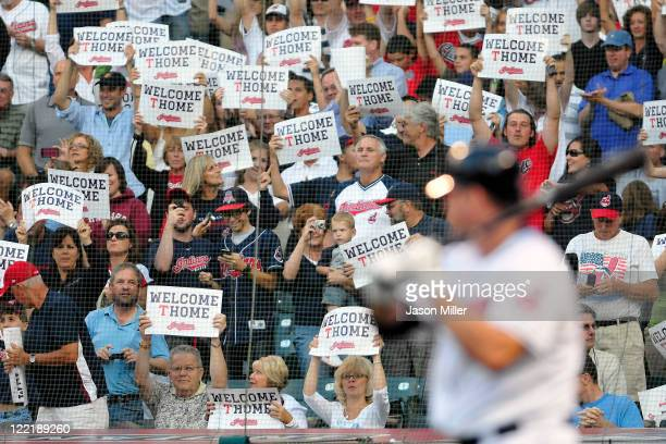 Cleveland Indians fans welcome Jim Thome of the Cleveland Indians back to the lineup for his first at bat during the second inning against the Kansas...