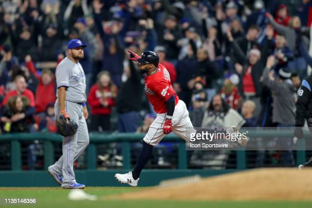 Cleveland Indians first baseman Carlos Santana celebrates as he rounds the bases after hitting a walkoff home run during the ninth inning of the...