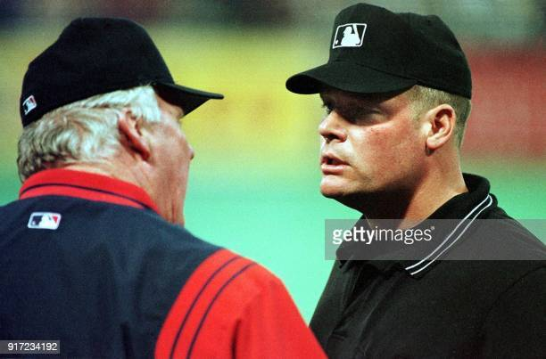 Cleveland Indians manager Charlie Manuel has words with first base umpire Ted Barrett about a call at first during their game against the Minnesota...