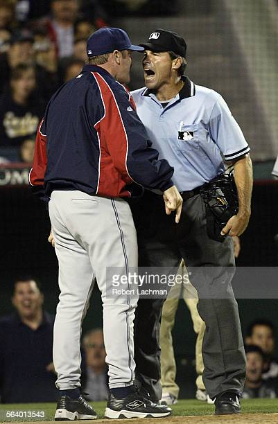 Cleveland Indians' manager Eric Wedge argues with home plate umpire Angel Hernandez after being thrown out of the game Wedge said his player Jhonny...