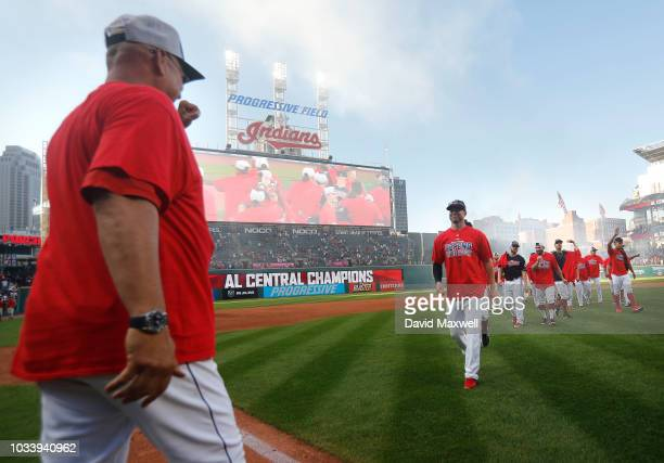 Cleveland Indians Manager Terry Francona congratulates players as they walk off the field during a post game celebration after the Indians defeated...