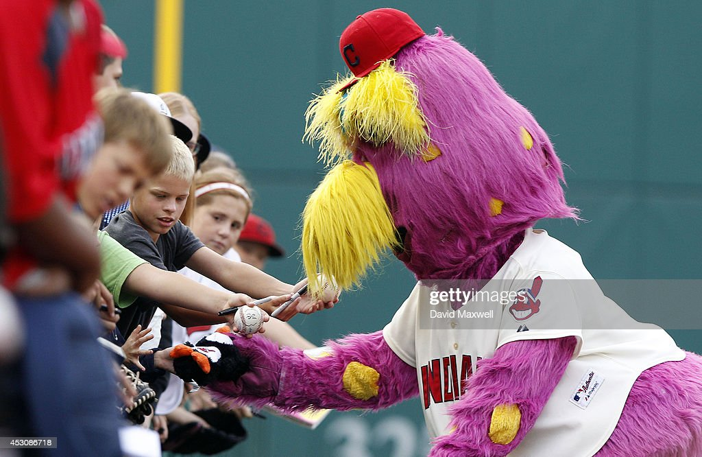 Cleveland Indians mascot Slider signs autographs for young fans before the start of the game against the Texas Rangers on August 2, 2014 at Progressive Field in Cleveland, Ohio.
