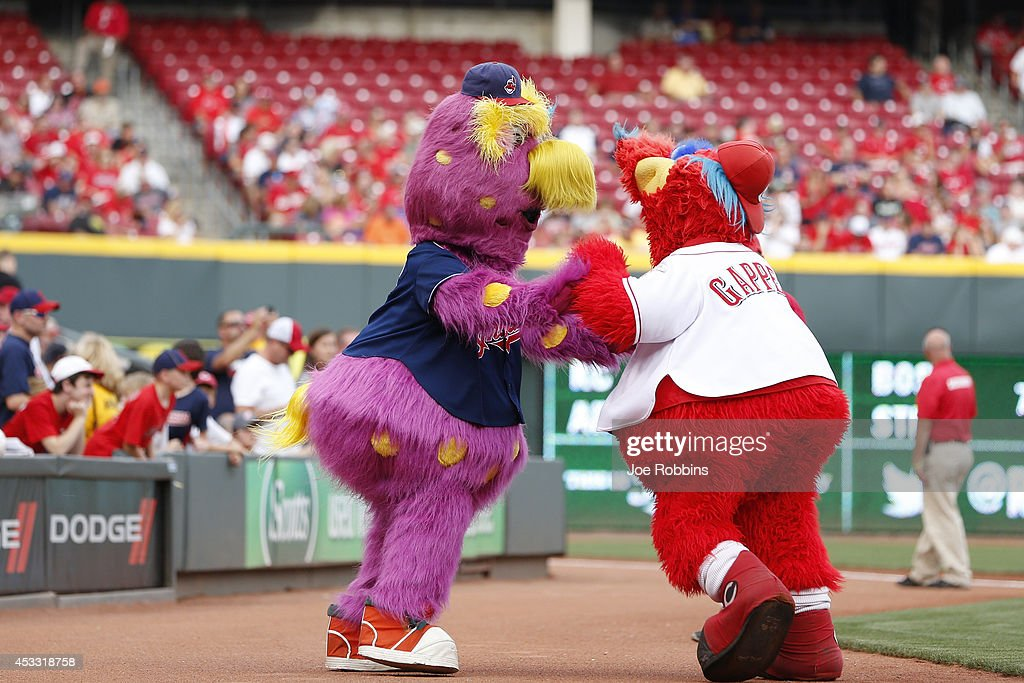 Cleveland Indians mascot Slider wrestles with Cincinnati Reds mascot Gapper before the game at Great American Ball Park on August 7, 2014 in Cincinnati, Ohio. The Reds won 4-0.