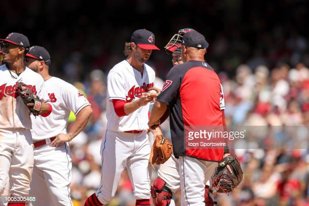 Cleveland Indians pitcher Adam Cimber hands the baseball to Cleveland Indians manager Terry Francona as he leaves the game during the eighth inning...