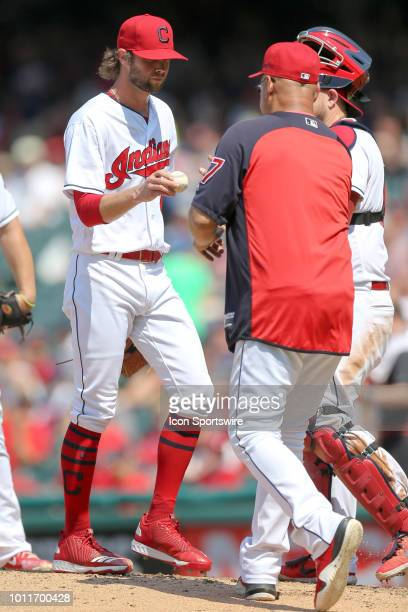 Cleveland Indians pitcher Adam Cimber hands the baseball to Cleveland Indians manager Terry Francona as he leaves the game during the seventh inning...