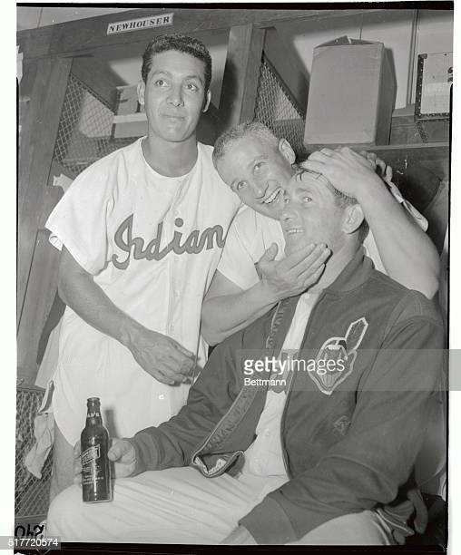 Cleveland Indians' pitcher Bob Lemon is congratulated by teammate Al Rosen in the dressing room after Lemon won his 22nd game of the season by...