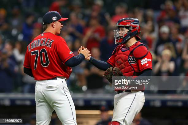 Cleveland Indians pitcher James Karinchak is congratulated by Cleveland Indians catcher Roberto Perez after striking out Detroit Tigers right fielder...