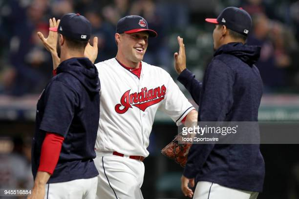 Cleveland Indians pitcher Matt Belisle gets highfives from Cleveland Indians starting pitcher Corey Kluber and Cleveland Indians starting pitcher...