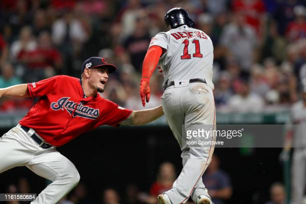 Cleveland Indians pitcher Nick Wittgren tags out Boston Red Sox third baseman Rafael Devers trying to score to end the tenth inning of the Major...