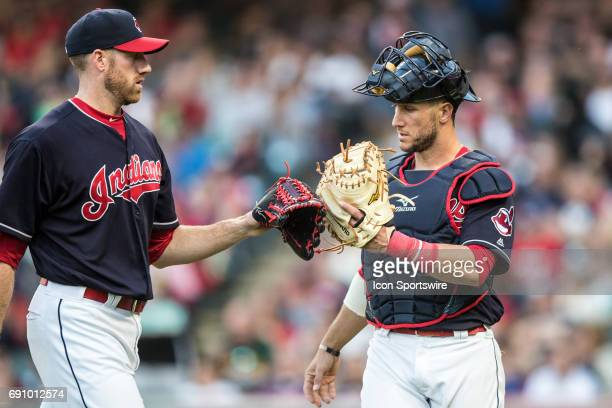 Cleveland Indians Pitcher Zach McAllister and Cleveland Indians Catcher Yan Gomes tap gloves following the eighth inning of the Major League Baseball...