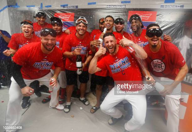 Cleveland Indians players celebrate in the locker room after the Indians defeated the Detroit Tigers 150 to clinch there American League Central...