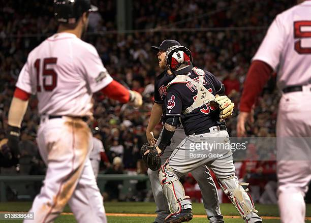Cleveland Indians relief pitcher Cody Allen and Cleveland Indians catcher Roberto Perez celebrate the 43 win as Boston Red Sox second baseman Dustin...