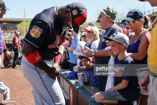 Cleveland Indians right fielder Abraham Almonte signs an autograph before the spring training baseball game between the Cleveland Indians and the...