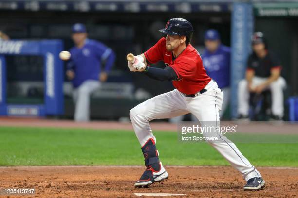 Cleveland Indians right fielder Bradley Zimmer bunts during the fourth inning of the the Major League Baseball game between the Kansas City Royals...