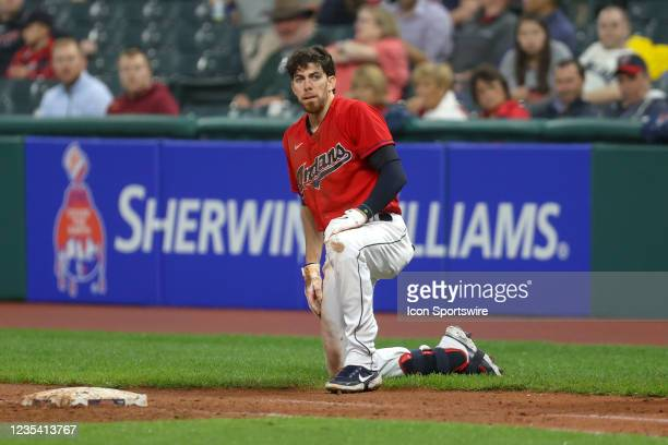 Cleveland Indians right fielder Bradley Zimmer is on one knee after being tagged out at first base after attempting to bunt for a hit during the...